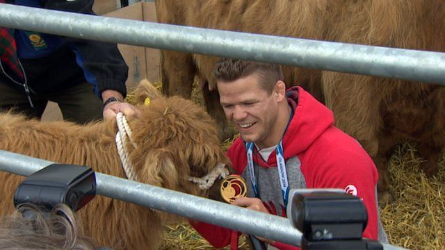 Canadian gold medallist and a Highland Cow