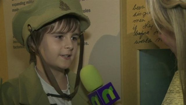 Little boy in a soldier uniform chatting to our presenter Jenny