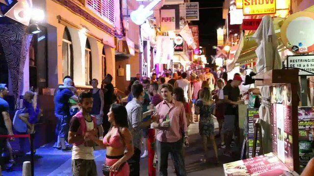 People on streets of Ibiza at night