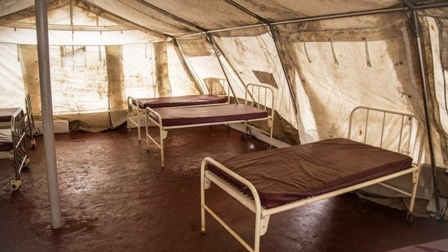 Beds inside a tent at an empty Ebola treatment centre in Sierra Leone