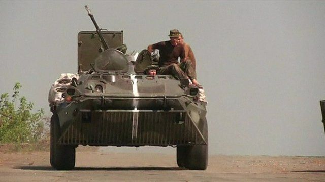 Ukrainian tank and soldiers