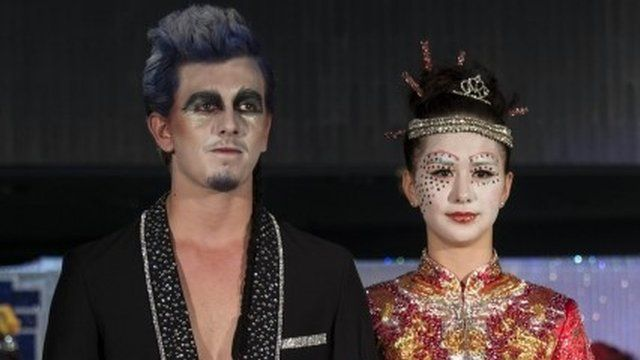 Models dressed as Chinese ghosts take part in a Funeral Fashion Show
