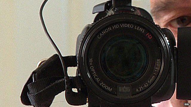 Man's face behind camera