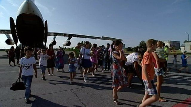 Ukrainian refugees getting off plane