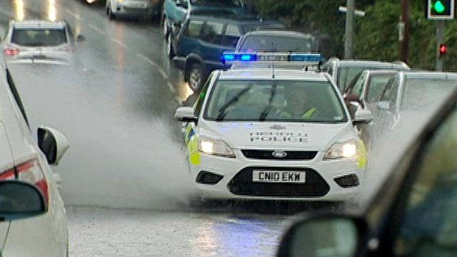 Police car in flooded road