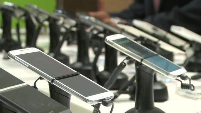 row of smartphones in a shop