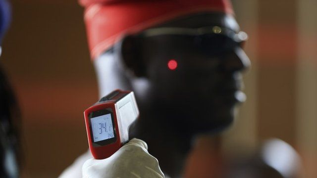 A man has his temperature taken using an infrared digital laser thermometer at the Nnamdi Azikiwe International Airport in Abuja, August 11, 2014