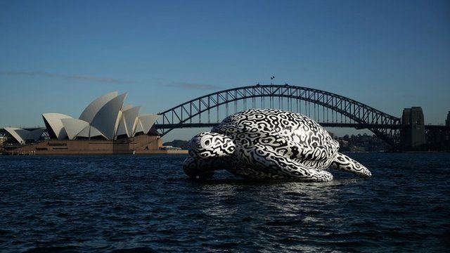 """To celebrate the World""""s First Undersea Art Exhibition, a 5 metre tall, 15 metre long Sea Turtle cruises past Sydney Harbour"""