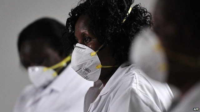Kenyan health officials wait for airline passengers in Nairobi