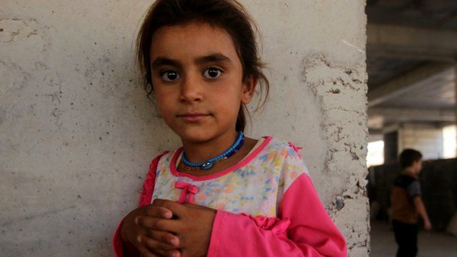 A girl that has fled her home in Iraq