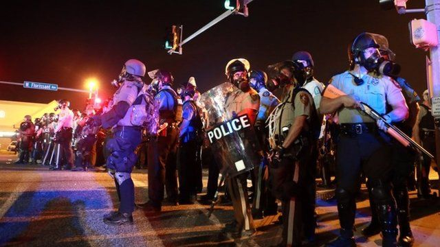 Police stand guard in Ferguson