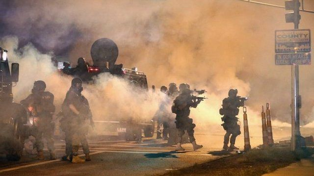 Police in Ferguson fire tear gas amid a tense stand-off with protesters