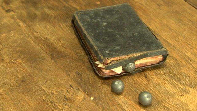 George Vinall's bible and three three shrapnel bullets