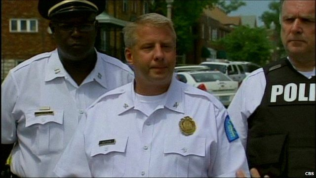 St Louis Police Chief Sam Dotson (centre) giving media briefing on latest shooting