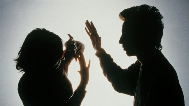 Posed shot of a man striking a woman