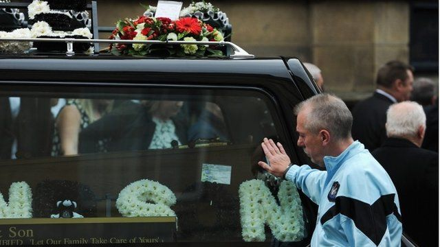 """A member of the congregation pays his respects during the funeral of lifelong Newcastle United fan Liam Sweeney as it takes place at St Mary""""s Cathedral on August 21, 2014 in Newcastle Upon Tyne, England"""