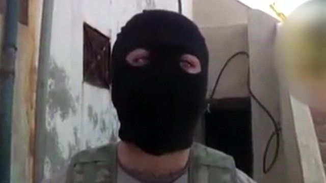 A British jihadist wearing a hood