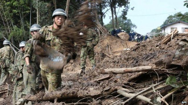 Japan landslide: Rescuers race to find survivors