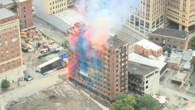 Colourful smoke can be seen from the Wellington Annex building as it is demolished