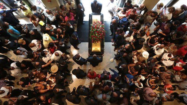 Michael Brown's casket leaves church