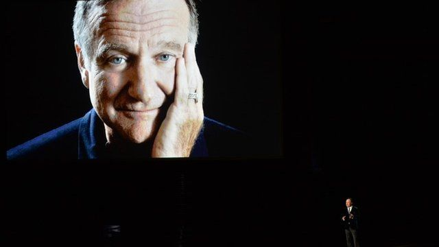Actor Billy Crystal (R) speaks in tribute to the late Robin Williams onstage at the 66th Annual Primetime Emmy Awards