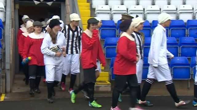 Coventry City Ladies Football Club members walk on to the pitch