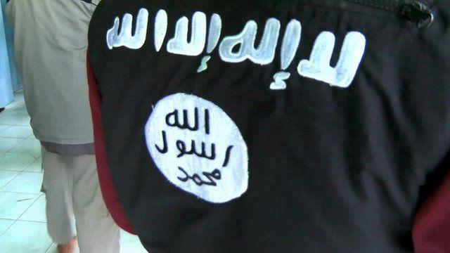 An Indonesian man wears the IS logo