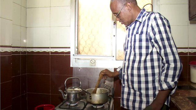 A man using one of Mogadishu's newly-introduced gas cookers