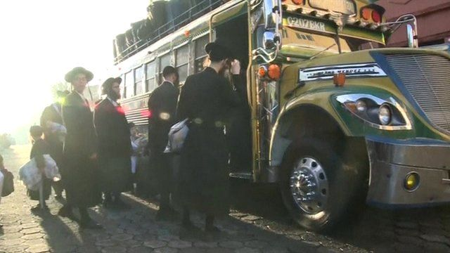 Members of Lev Tahor boarding bus