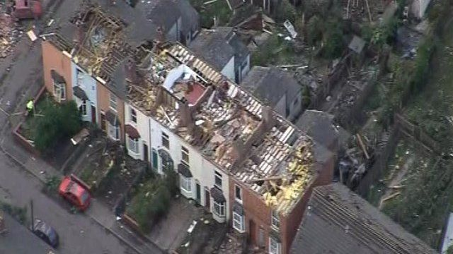Aerial view of houses damaged by the tornado