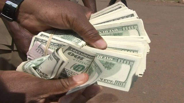 A handful of dollar bills