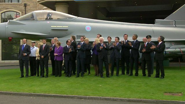 Nato leaders family photo in front of aircraft, Newport