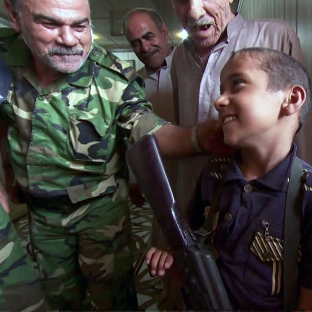 The children with AK-47s who defied IS