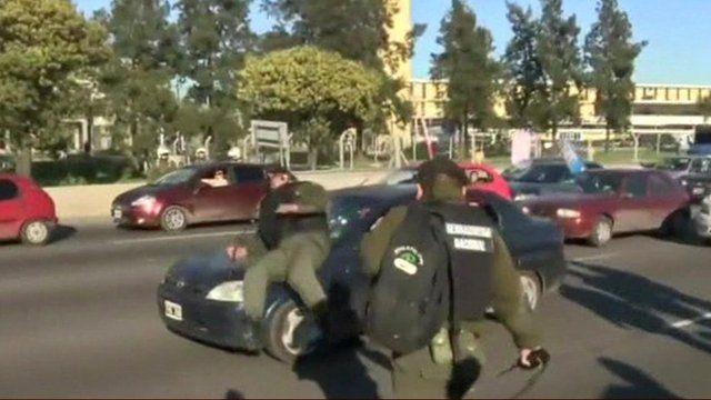 Police officer on car