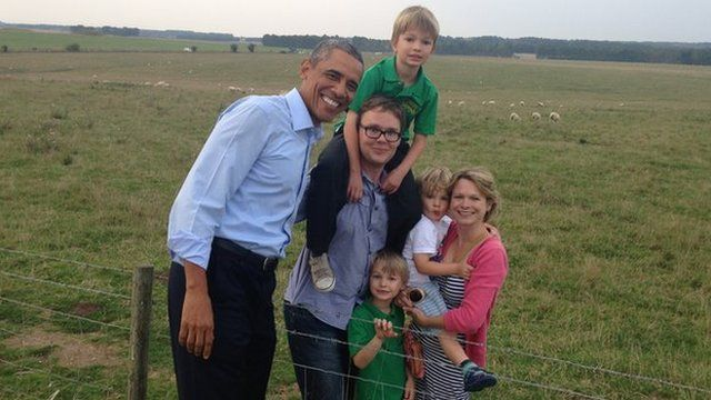 Barack Obama and a visiting family
