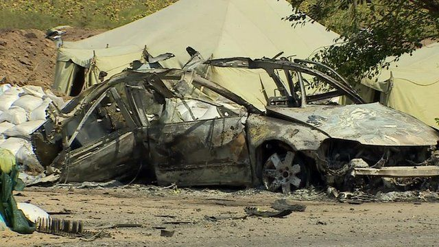 A burnt-out vehicle in Mariupol