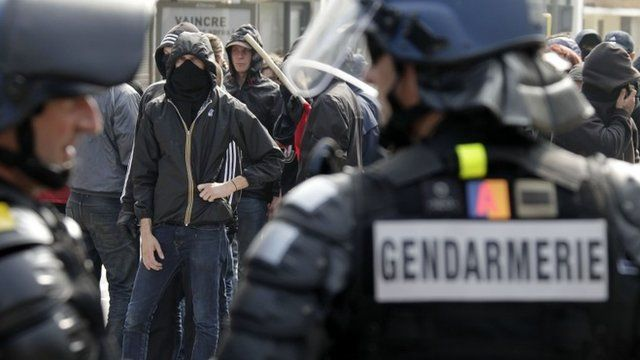 Anti-fascist activists confront police in Calais, northern France, Sunday, Sept 7, 2014