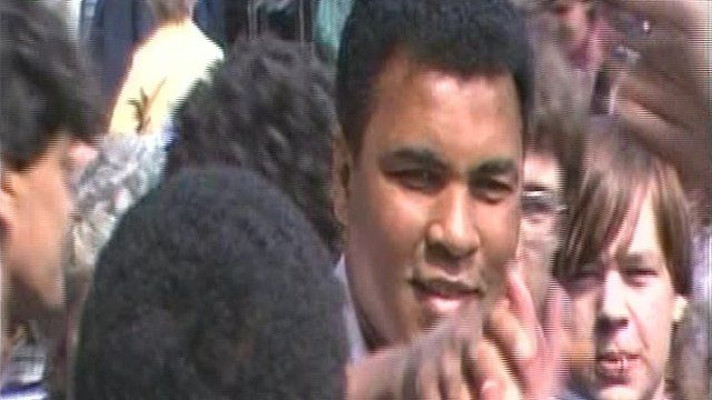 Muhammad Ali is mobbed by crowds in Birmingham