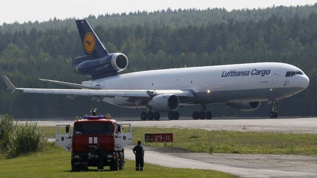 A McDonnell-Douglas MD-11 jet of Lufthansa Cargo AG taxis along the tarmac of Yemelyanovo airport, on its way to Frankfurt from Shanghai, outside Russias Siberian city of Krasnoyarsk August 16, 2014. Lufthansa Cargo AG use the Krasnoyarsk airport as the transit airport for fuelling and maintenance on its long-distance flights to and out of Europe