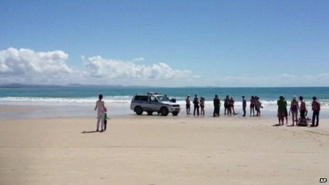 People on Byron Beach after death of man in shark attack