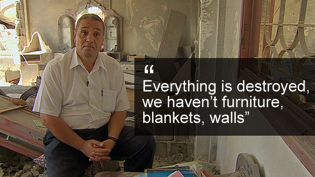 English teacher Abdul Karim Abu Ahmed in his ruined home