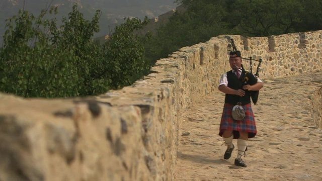 Chinese bagpiper on Great Wall of China