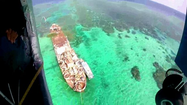 Aerial view of rusting Philippine ship, Sierra Madre