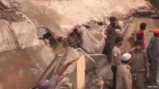 Rescue workers at site of collapsed mosque