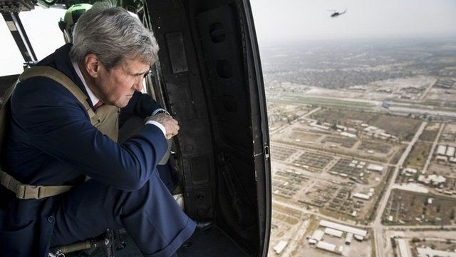 John Kerry looks out of a helicopter over Baghdad as he arrives in Iraqi capital to meet newly-formed government