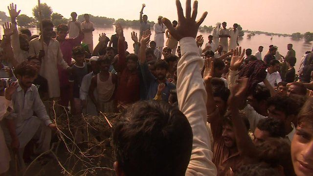 People chanting with arms raised