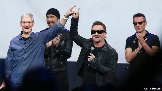 Apple CEO Tim Cook and U2