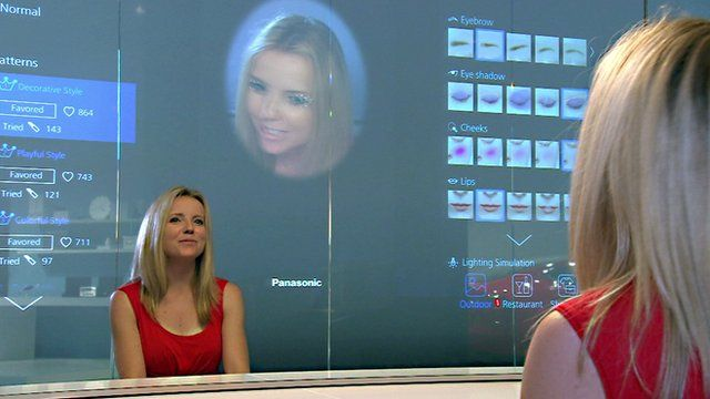 Click reporter Jen Copestake looking at a smart mirror