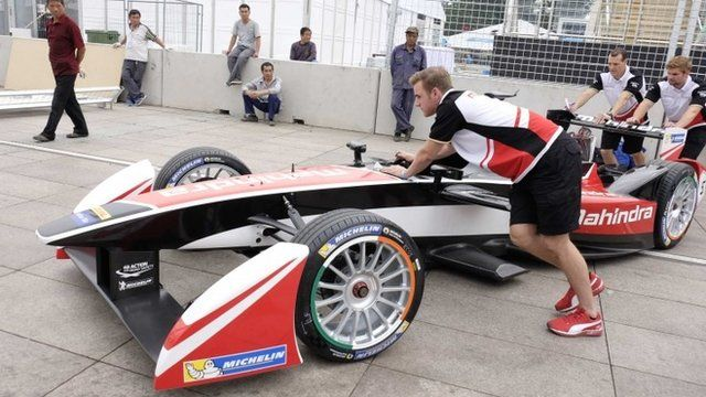 Engineers prepare for the upcoming Formula E Championship race on Saturday in Beijing