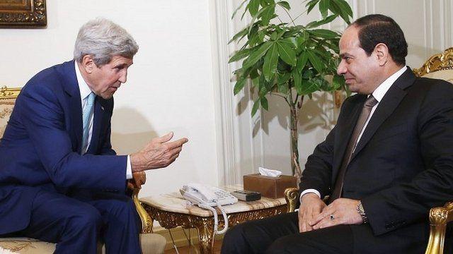U.S. Secretary of State John Kerry (L) speaks with Egyptian President Abdul Fattah al-Sisi in Cairo